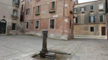 A Fountain In Empty Venice Street