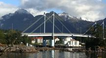 Scenic Boat Harbor, Bridge And Alpine Scenery.