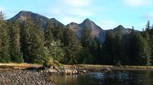 Alaska Beach Scene. Rocky Beach & Mountain Background.