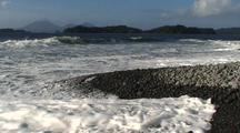 Remote Rocky Beach With Volcano In Background