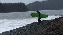Surfer With Board Enters Water, Remote Alaska Surfing