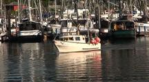 Fishing Boat Leaving A Harbor.
