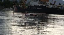 A Float Plane Passing A Coast Guard Boat/Ship.