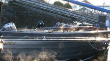 Steam Rising From A Group Of Boats (Skiffs)