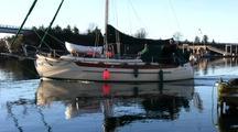 Sailboat Passing Through A Harbor
