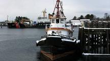 Tug Boat & Coast Guard Buoy Tender At Dock.