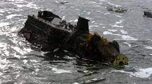 Polution: Part Of A Boats Engine Block Lying In The Surf.