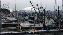 Fishing Fleet  In Port & Volcano Background.