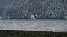 Coast Guard Cutter In A Snow Covered Bay/Fiord