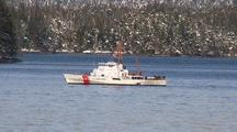 Coast Guard Cutter In A Snow Covered Bay.