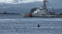 Coast Guard Cutter  & Winter Surfers
