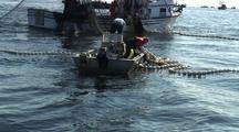 Fishermen Work A Corkline  During The Sitka Sound Sac Roe Herring Fishery