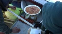 Fish Technicians Weigh Herring Eggs