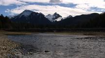 Alpine Scene: A Small Stream & Snow Capped Mountains