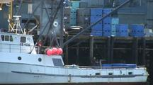 Commercial Fishing Boat Unloads Fish Totes.