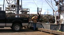 Commercial Fishing: Unloading Crab Pots (Traps).