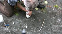 Pouring Plaster To Make A Plaster Cast Of A Animal Track