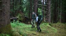 Fishermen Hike In Wilderness