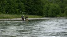 Fly Fishermen Hike Across Stream
