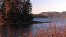 Sunset Scene: Secluded Beach In Alaska & Small Cabin