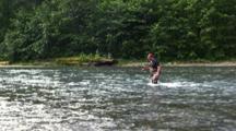 A Fisherman Crosses A River