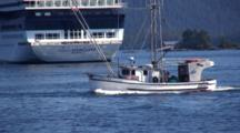Commercial Fishing Boat Passes A Cruiseship