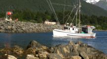 Commercial Fishing Boat Enters A Harbor
