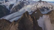 Aerial Cineflex Rugged Jagged Peaks Of Kenai Peninsula Toward Ancient Glacier Carving Through Valley