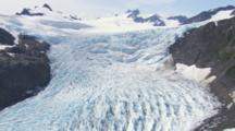 Cineflex Aerial Medium Shot Slow Tilt Down Over Deep Crevasses And Cracks Of Glacier Ice Field