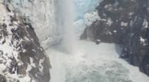 Aerial Cineflex Tight On Glacier Waterfall Meltwater Runoff Pull To Wide Shot Of Dramatic Tidewater Glacier