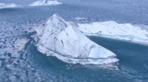 Aerial Cineflex Pan With Dramatic Iceberg From Calving Glacier