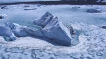 Aerial Cineflex Pan Around Huge Dramatic Icebergs In Ice Choked Glacial Waters