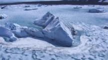 Aerial Cineflex Pan Around Huge Dramatic Icebergs In Ice Choked Glacial Waters