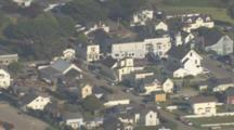 Aerial View Of Coastal Mendocino California Pull From Tight On Neighborhood To Wider Shot Of Coast