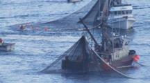 Cineflex Aerial Sitka Herring Fishery Boats With Nets Out People Busy Working Tight On Two Boats Hauling Back Nets