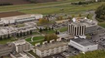 Large Satellite Dish Atop Building, Pull Back Reveal Uaf University Of Alaska Fairbanks Campus Surrounded By Boreal Forest. Cineflex Aerial Of Alaska By Zatzworks