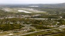 Cineflex Aerial Of Fairbanks Alaska City With Alaska Airlines Jets On Tarmac At Fairbanks International Airport, Pull Back To Reveal Fairbanks Entire Runway And View Of Fairbanks. Cineflex Aerial Of Alaska By Zatzworks