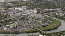 River Flows Through Sprawling Fairbanks Alaska Metropolis, Zoom To Reveal Downtown Business District. Cineflex Aerial Of Alaska By Zatzworks