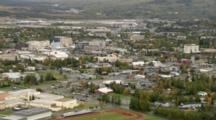 Small Residential Area Near Downtown Business District,  Pull Back To Reveal Sprawling Fairbanks Alaska Metropolis, High School And Ball Fields. Cineflex Aerial Of Alaska By Zatzworks