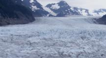 Cineflex Aerial Of The Glacial Ice Of Sheridan Glacier Tilt Up Towards The Glacier Head In The Chugach Mountains, Chugach National Forest, Copper River Delta Near Cordova, Alaska Prince William Sound.