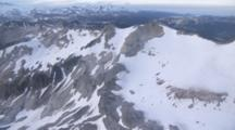 Cineflex Aerial Of Flying Through The Aleutian Mountains Tilt Down To A Rocky Spine And Ice, Katmai National Park, Alaska