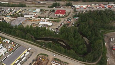 Aerial Over City of Anchorage,Alaska,Industrial Buildings next to River
