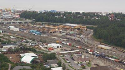 Aerial Over City of Anchorage,Alaska,railroad yard,industrial area