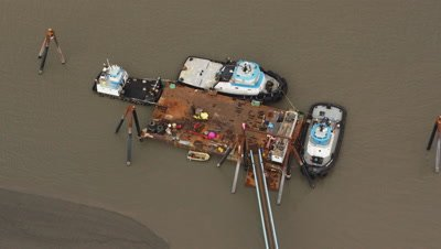 Aerial,boats tied to rusty dock