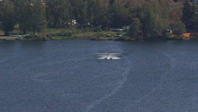 Floatplane Prepares For Takeoff On A Lake