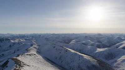 Aerial Grand Vista,Expansive Snow-Covered Mountain Range