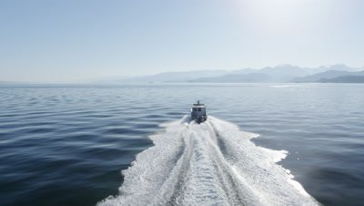 Aerial View From Behind,Motor Boat Travels Off Alaska Coast