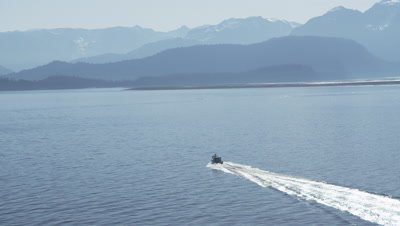 Aerial View Motor Boat Travels Off Alaska Coast,Tilt and zoom to very wide