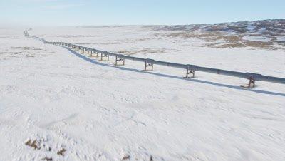 UHD aerial of transalaska pipeline in winter snow