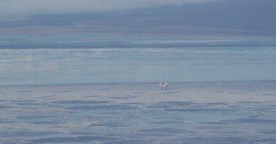 Oil Platform in Vast,Barren Alaska Landscape